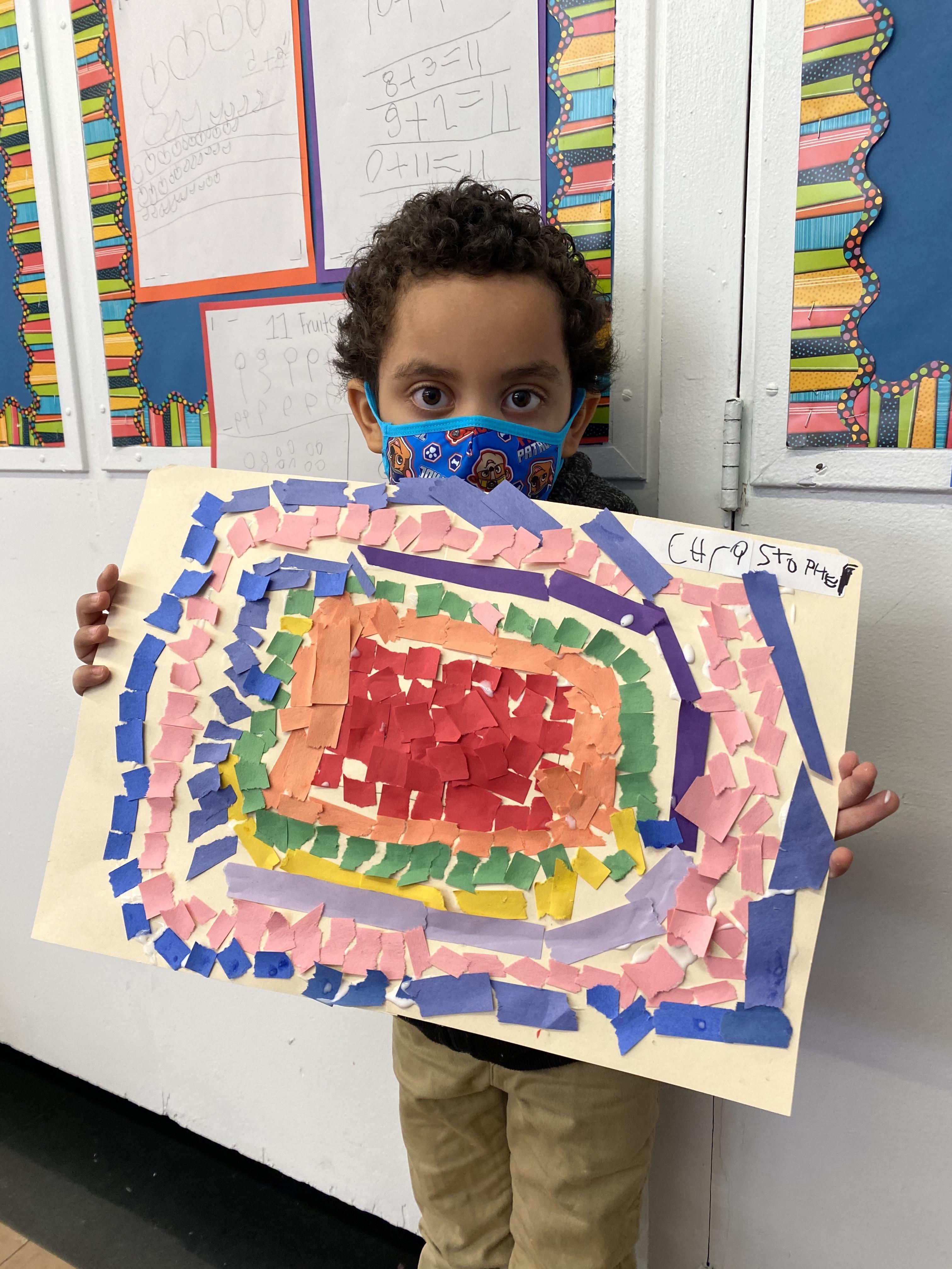 boy holding mosaic project