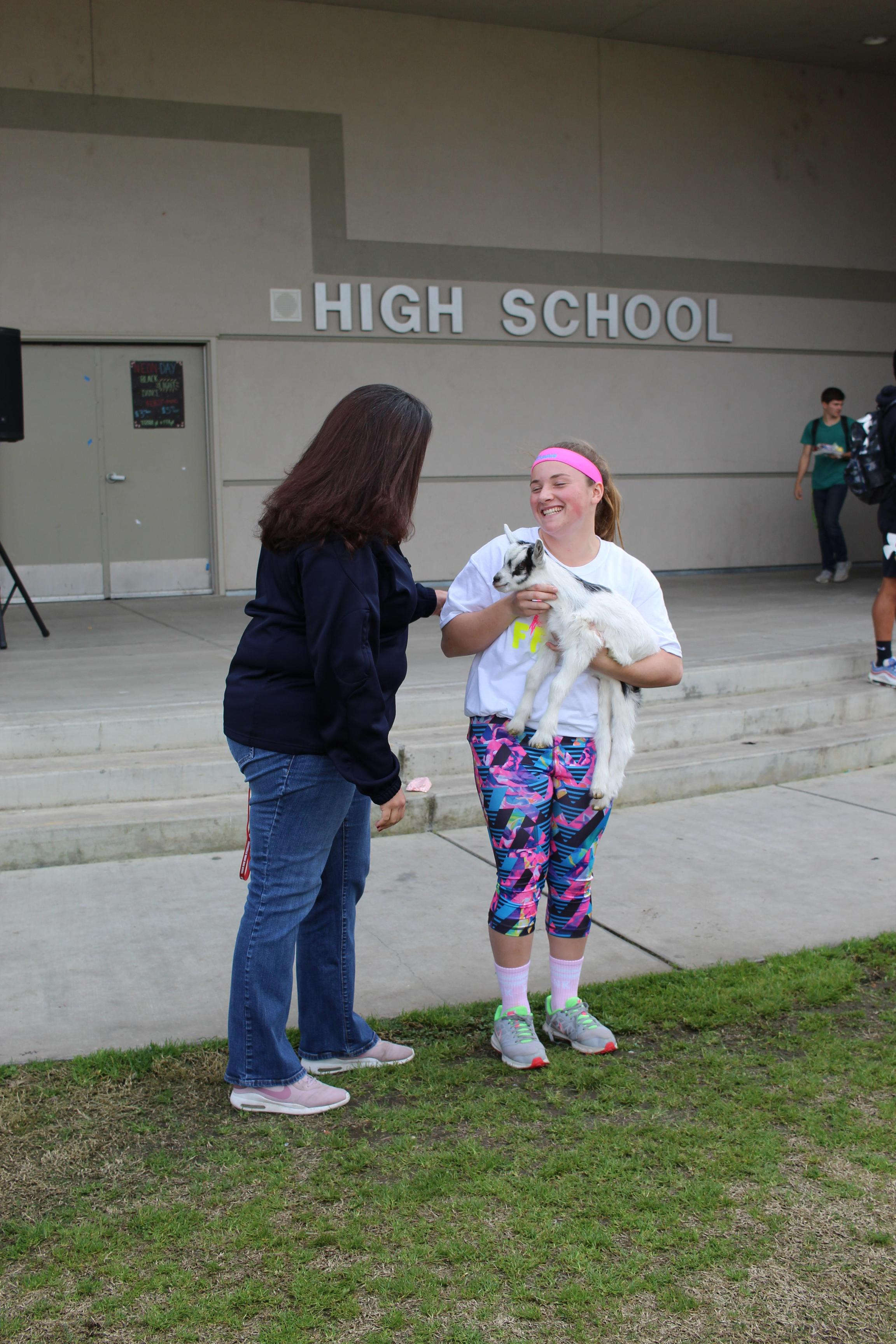 Mrs. Labendeira kissing Rachel Mancebo's goat