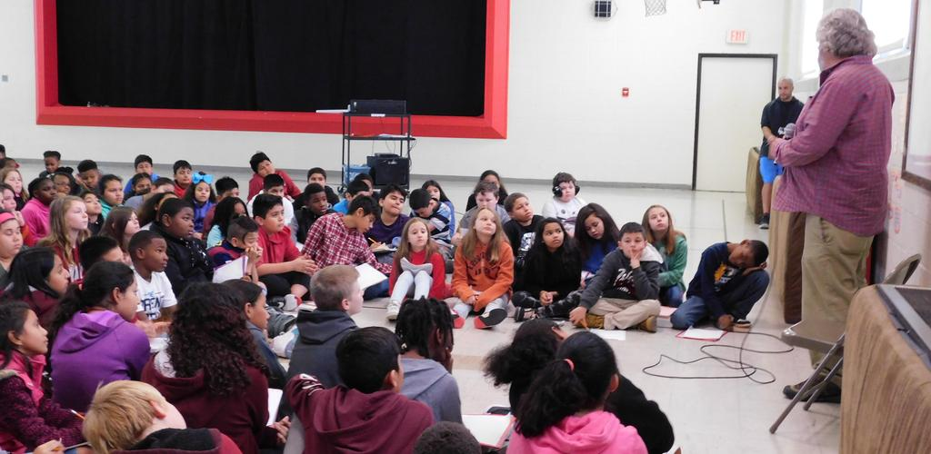 author talking to students