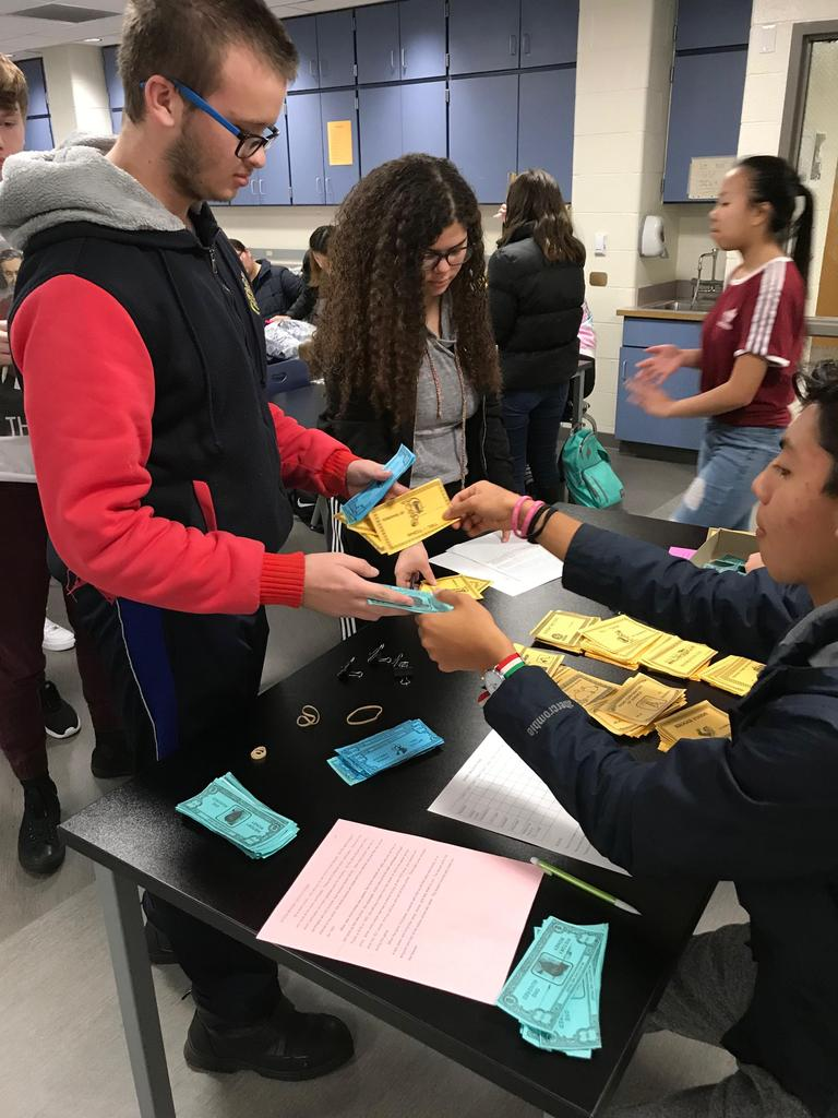 Students in Mr Thompson's history class look to make money in a History Stock Market Game.