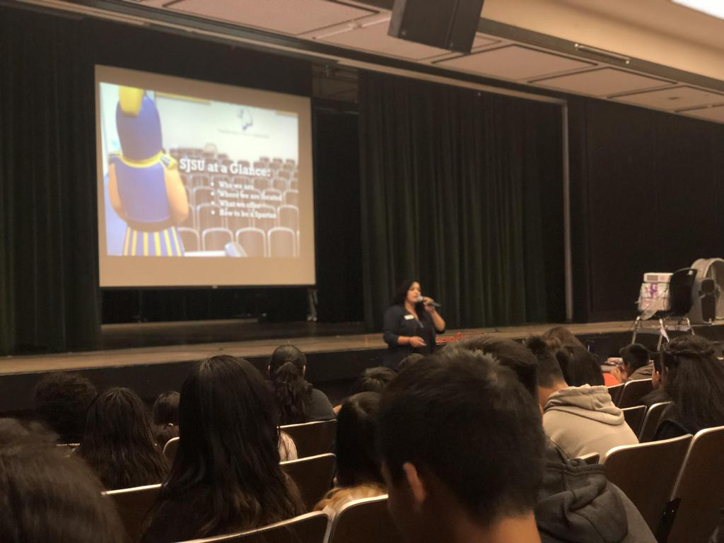 A representative from San Jose State talking to the students about college.
