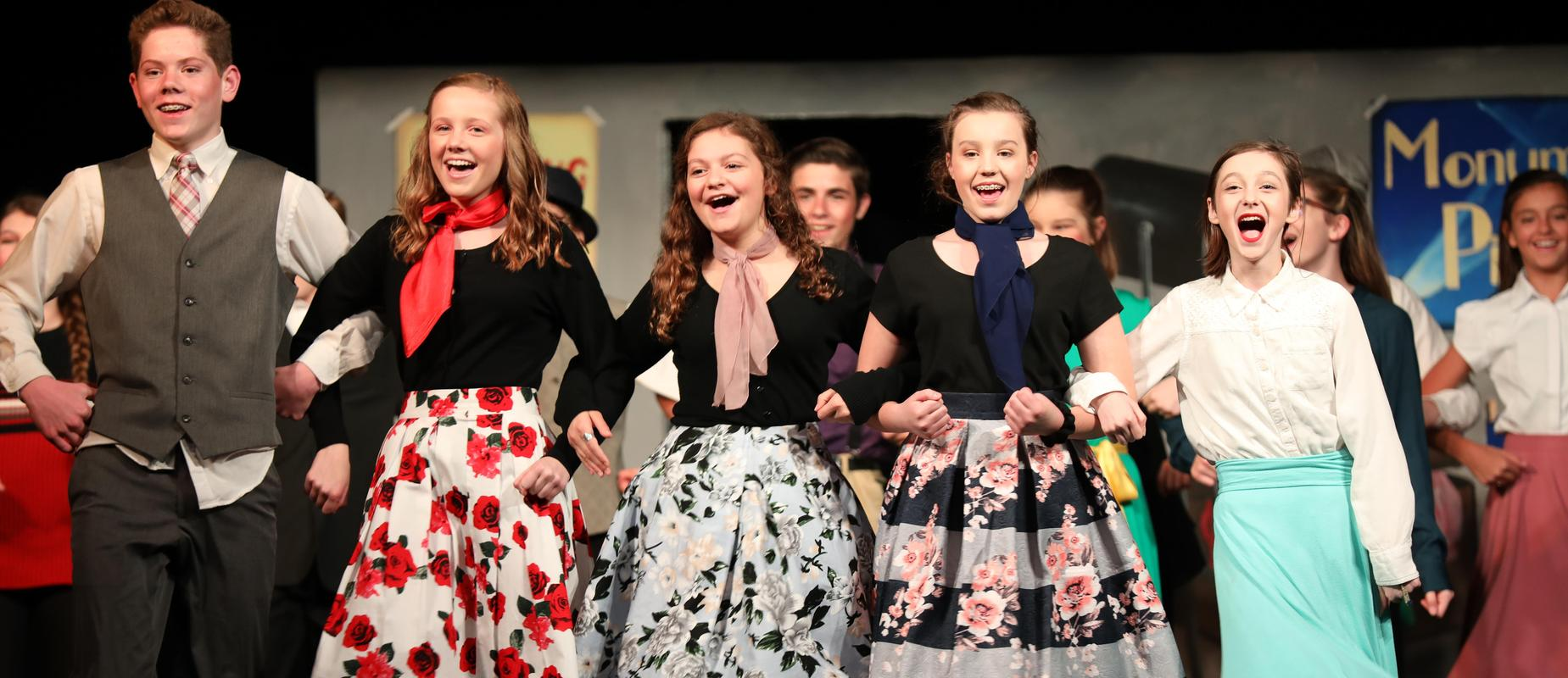 Singin' in the Rain Jr. Musical cast members singing