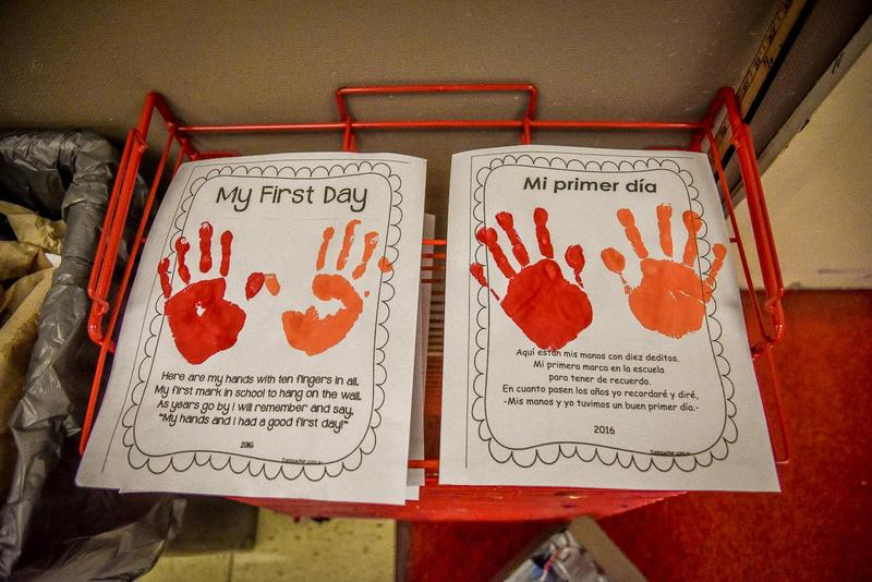 Art project with painted handprints about the first day of school