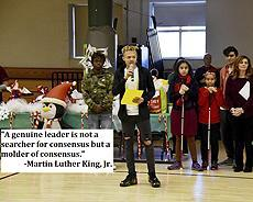 "Image: The student council president speaking at a school assembly. ""A genuine leader is not a searcher for consensus, but a molder of consensus."" -Martin Luther King, Jr."