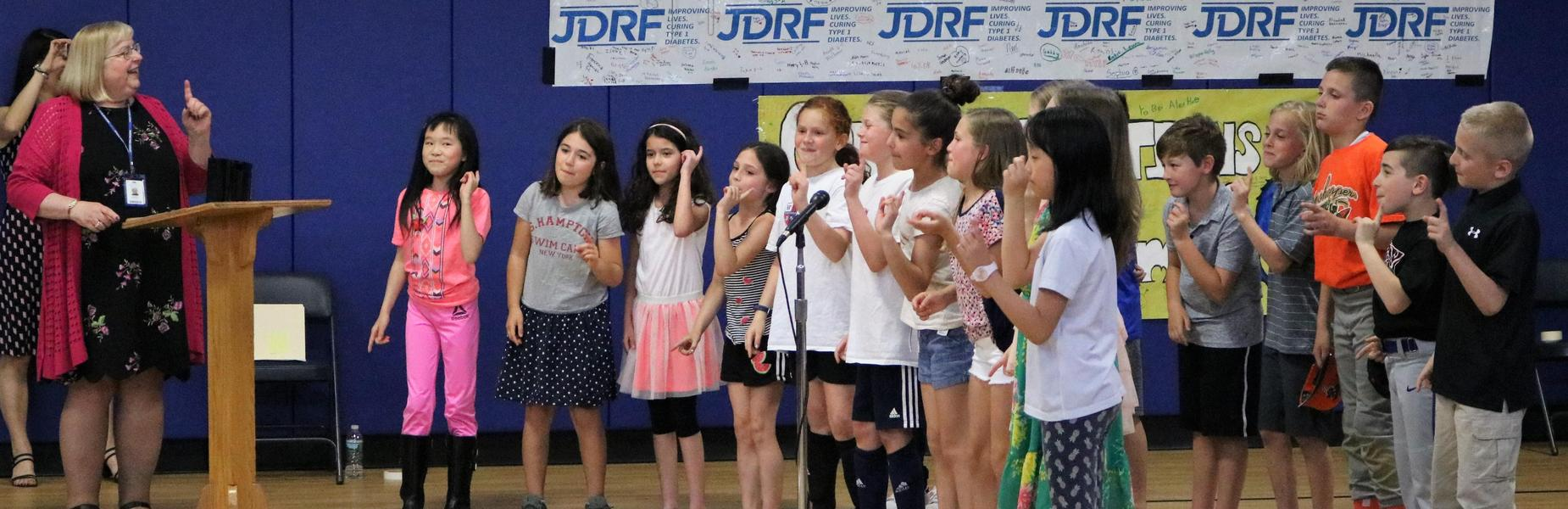 Photo of Jefferson School 4th graders sing for their teacher, Anna Carissimo, at the May 7 Board of Education meeting where she was honored as the the recipient of the 2019 Charles Philhower Fellowship Award.