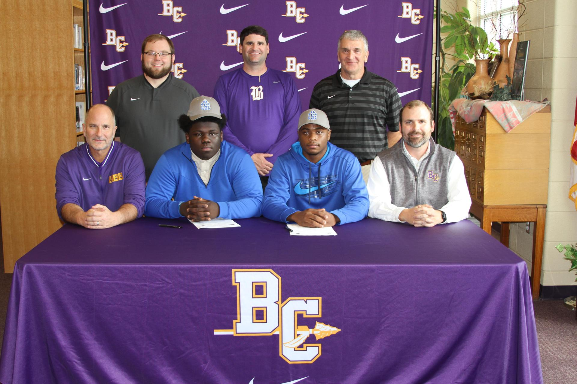 Noah Dukes and Dexter Marsh with football coaches