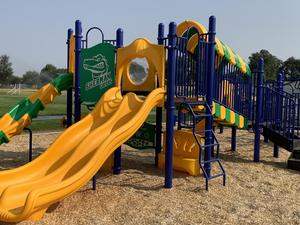 Green and yellow slide and climbing equipment at Sherman Elementary School.