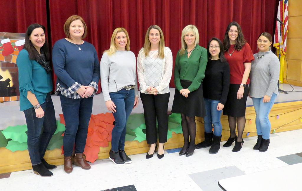 From left: Math Interventionists Jennifer Tulipani and Michelle Villano, Literacy Interventionist Melissa Patti, Director of Literacy and Title I Michelle Rooney, Data Coach Jennifer McCarthy, Literacy Interventionist Karen Tohmc, Title I Parent Liaison Tammy LaRosa, and Translator/Guidance Intern Fernanda Andrade.