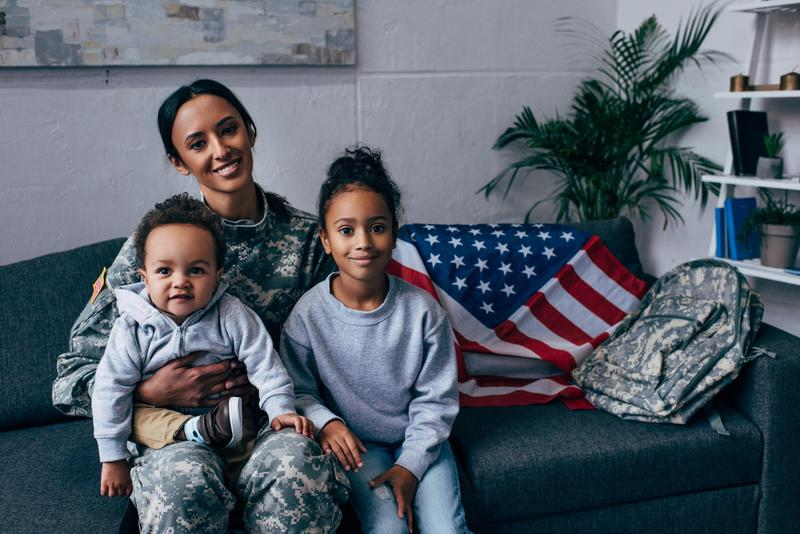 A solider with two young children.