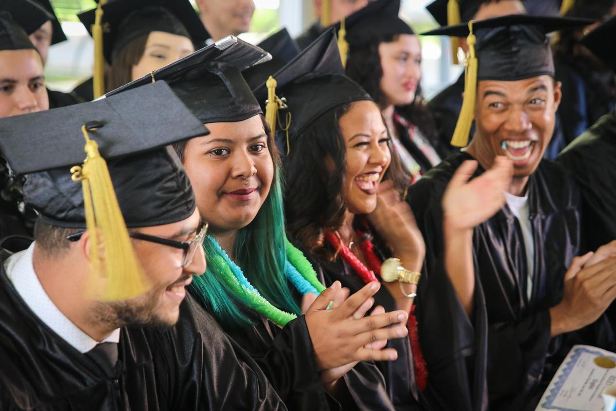 Graduates clap during the South LA site graduation