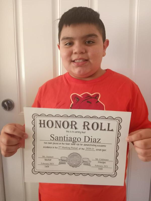 Santiago holding honor roll certificate