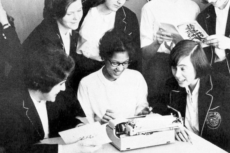Gail (middle, bottom row) and other St. Mary's students putting together the 1963 issue of The Pendulum, the School's yearbook.