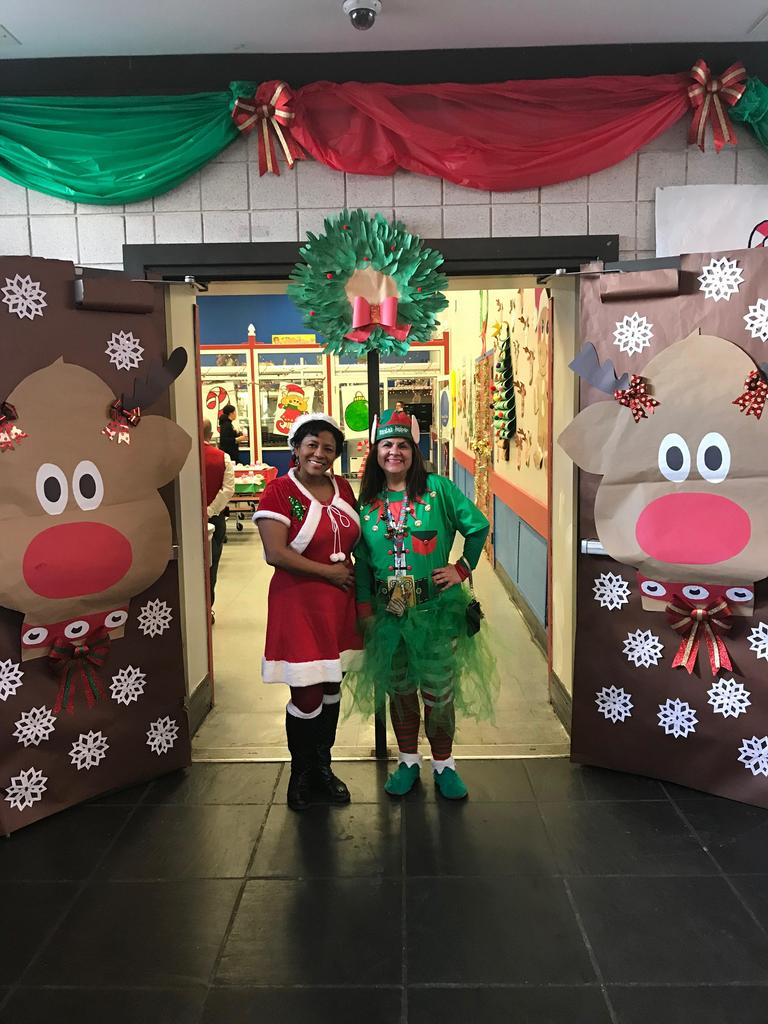 parent liaison vandherhorst as ms. snata with clerk letty as a elf