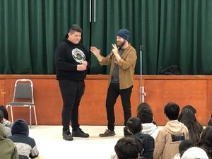 A volunteer and magician Wayne during one his tricks.