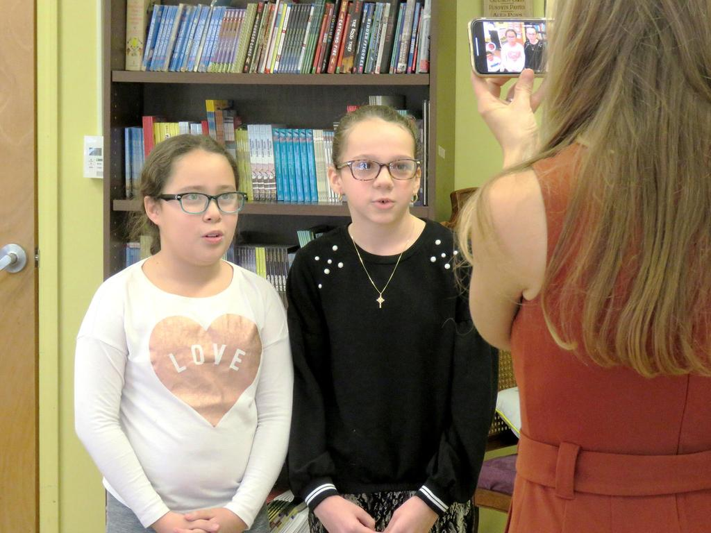 "Kelly Ann Cicalese films a segment with fifth graders Hailey Castaneda and Julia Velasquez for the NewsCenter 5's ""Weekend EyeOpener"""