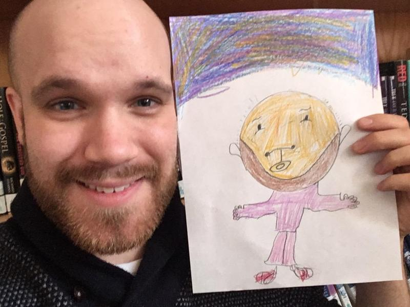 Mr. Pokel holding a drawing of himself