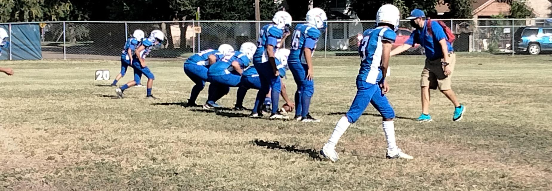 8th grade football team getting ready before a game.
