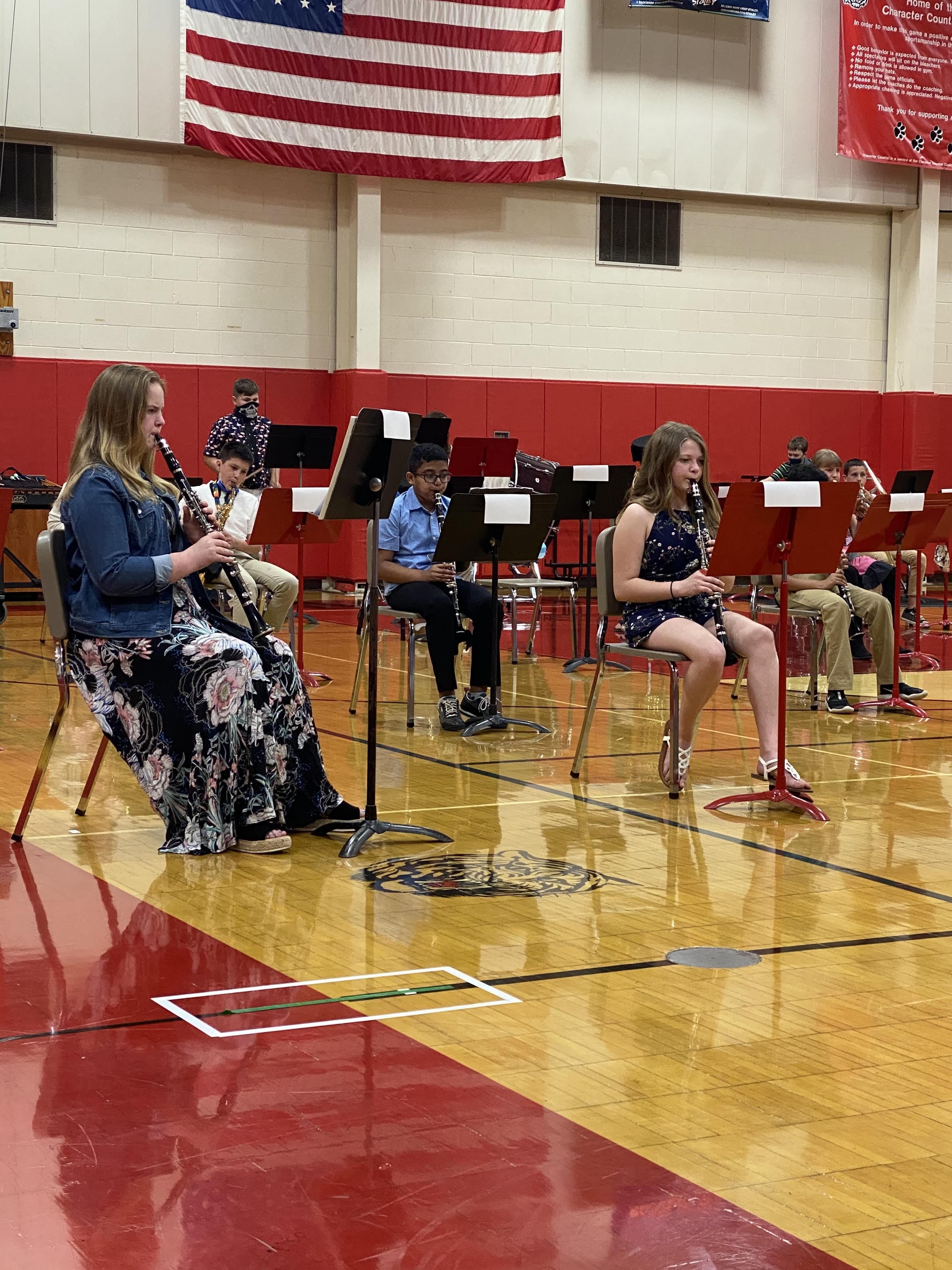 A group of students holding band instruments in the Benjamin gym