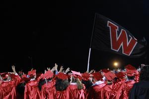 victoria west high school seniors singing their school song and waving their school flag at the 2018 graduation ceremony