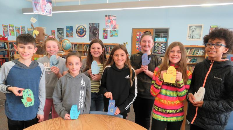 Page students show some of the Mitten State decorations they made for the musher's banquet before the start of the Iditarod.