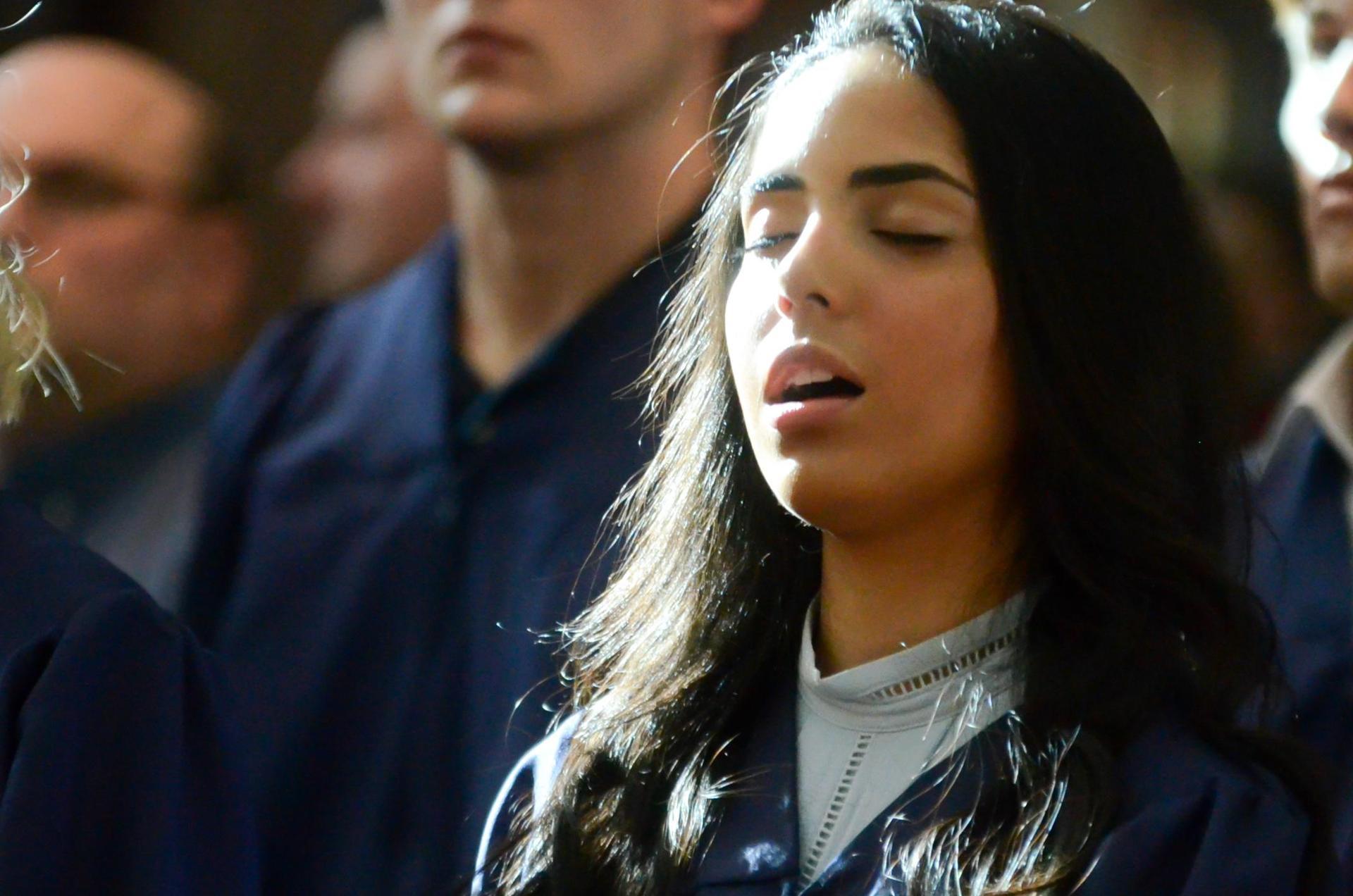 Girl singing during chapel