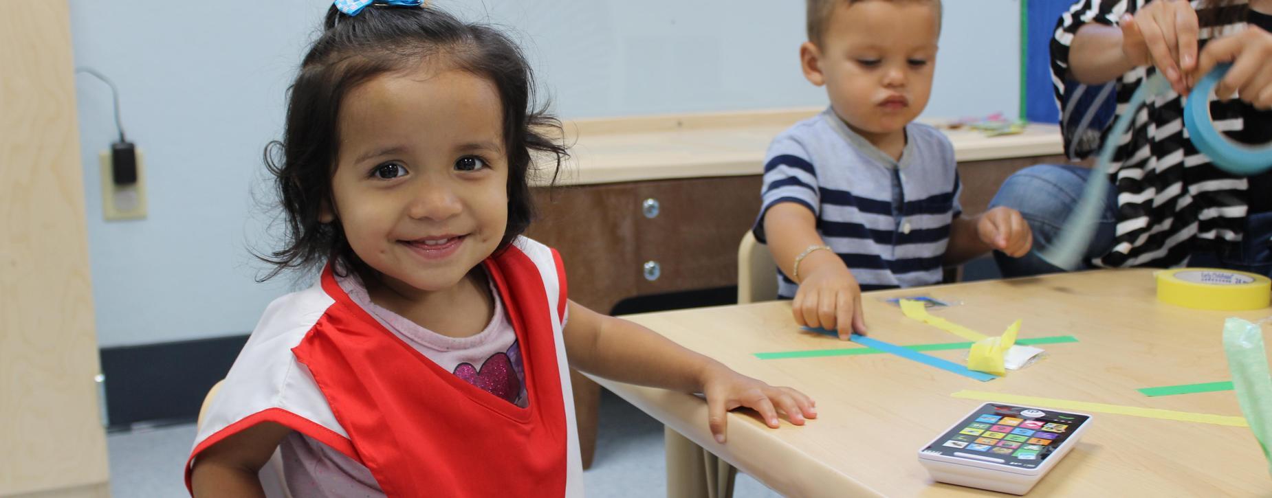 Preschool with toy smartphone