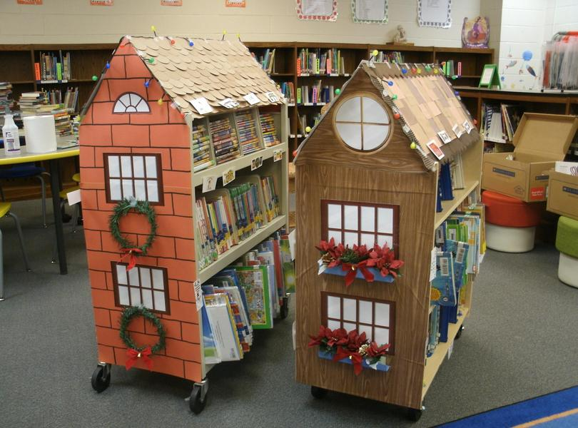 Books houses decorated for the holidays.