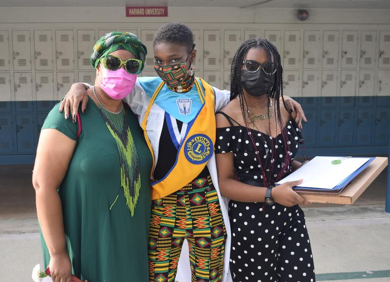 Baldwin Park High School valedictorian Isis Kohle Jackson (center) earned multiple scholarships during the school's Senior Recognition Night on May 25. Jackson celebrates her accomplishments with her mom Dionne Jackson, who is a teacher at Santa Fe School, and her sister and Braves sophomore Silence Jackson.