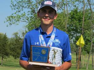 Photo of WHS golfer Colin Summers holding Tournament of Champions trophy.