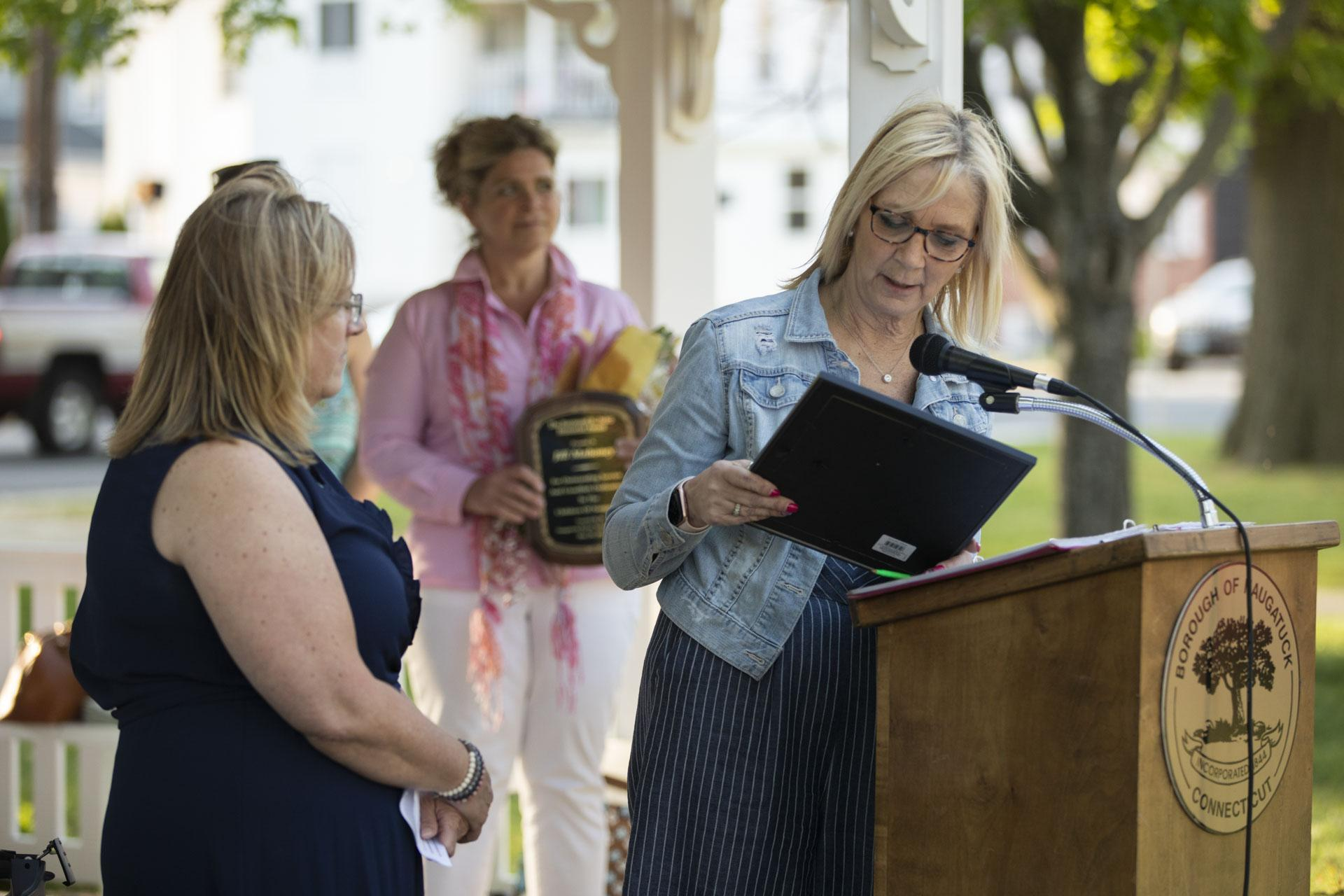 Laurie Jackson presenting citation to Jill Mahoney