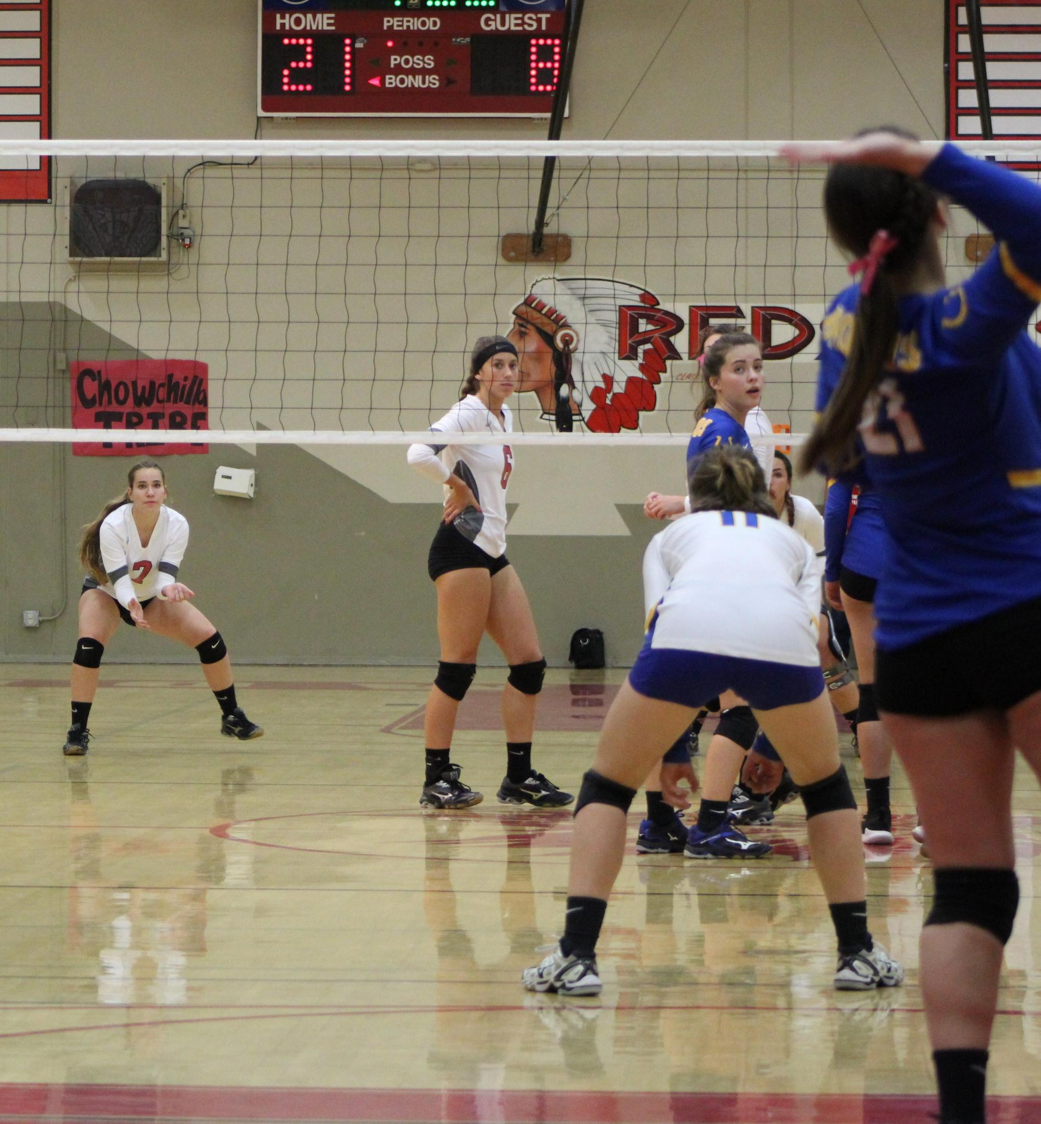 Girls playing volleyball against Dos Palos