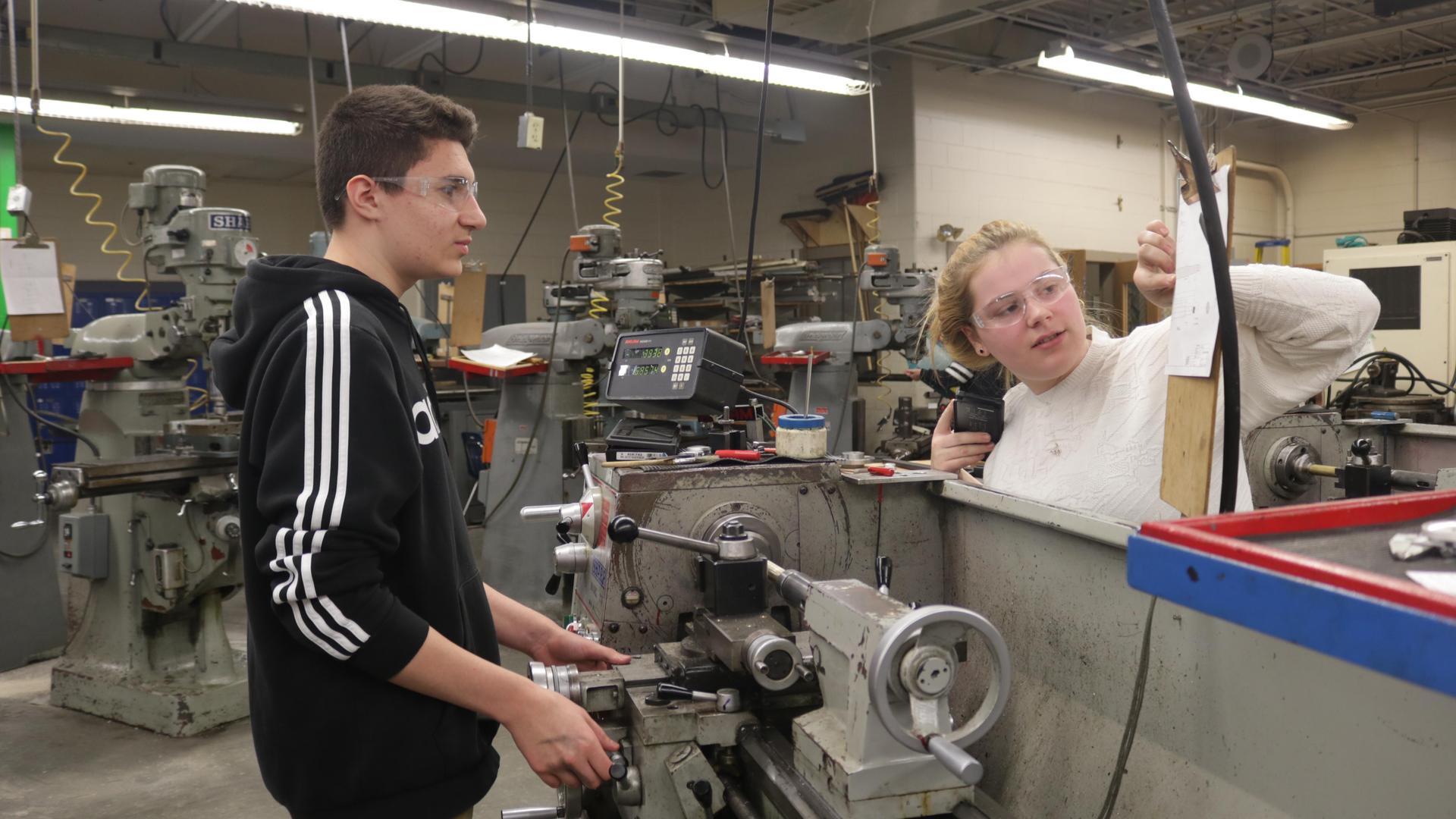 Students working on machine