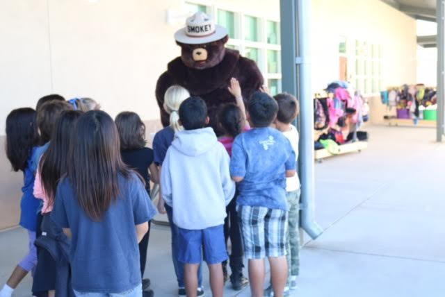 Students with Smokey the Bear.