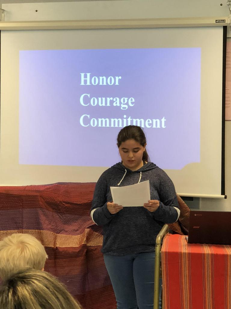 "Student presenting on ""Honor, Courage Commitment"""