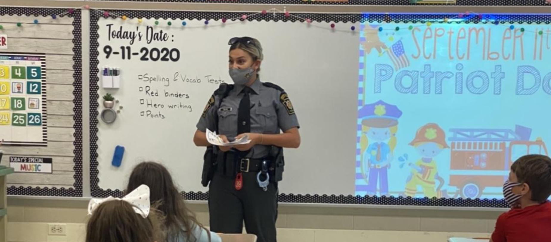police officer talking to students