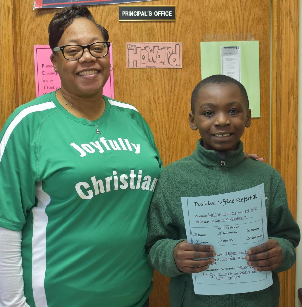 A student is celebrated for positive behavior