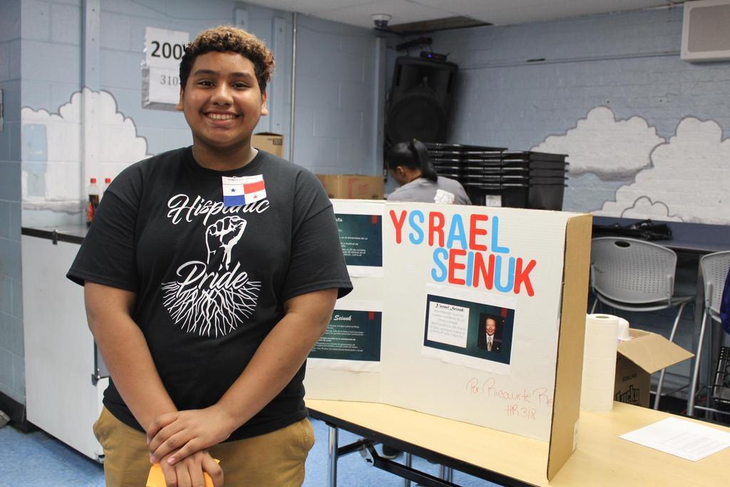 boy with his presenation on israel seinuk