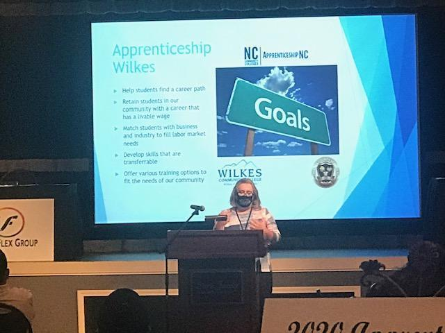 Mrs. Beth Foster, Workforce Development Coordinator at WIlkes County Schools giving an overview of the Apprenticeship Wilkes goals.