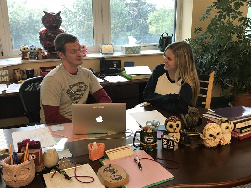 image of Mr. Rodgers holding a writing conference with a student in the OWL Center