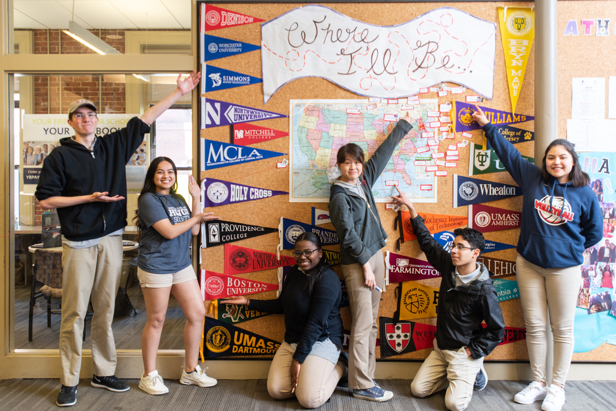 PHA seniors pointing at college map