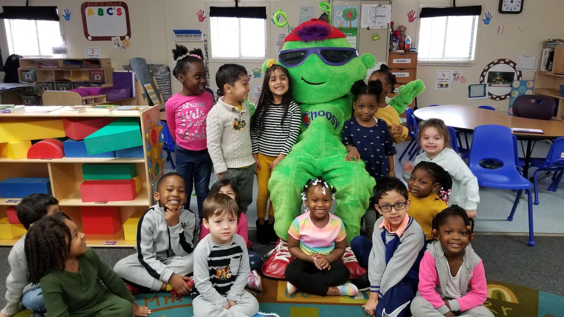 Students celebrating a visit from healthy habit mascot Choosy.