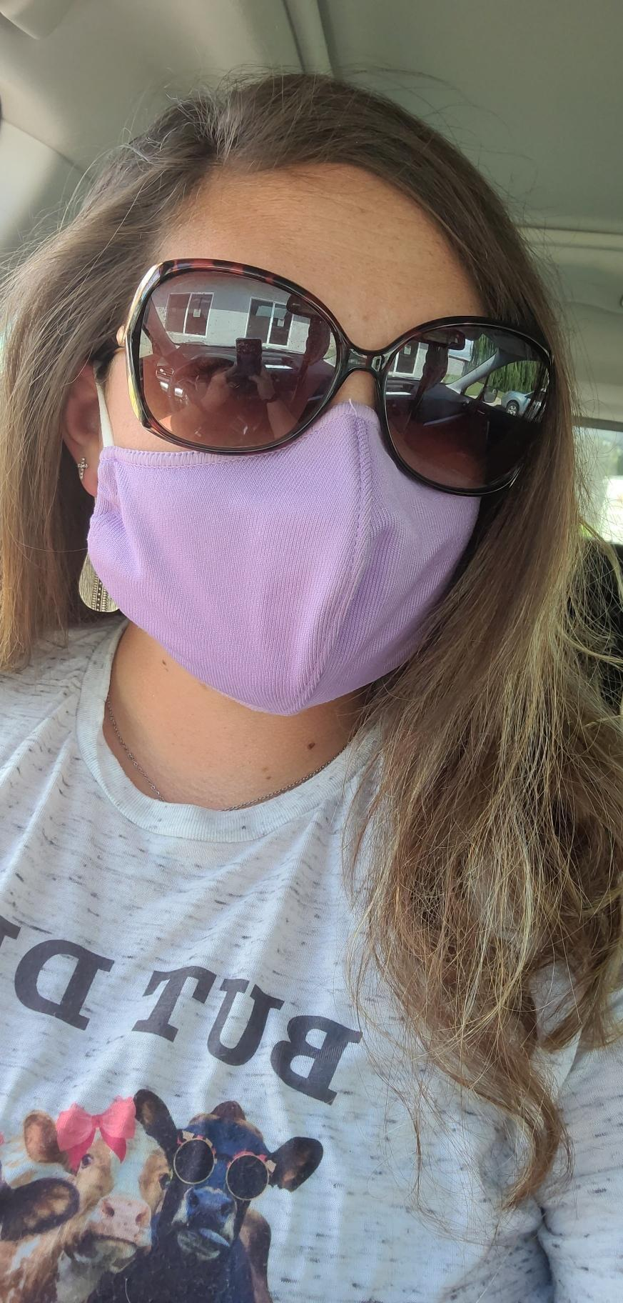 staff member close up wearing pink mask