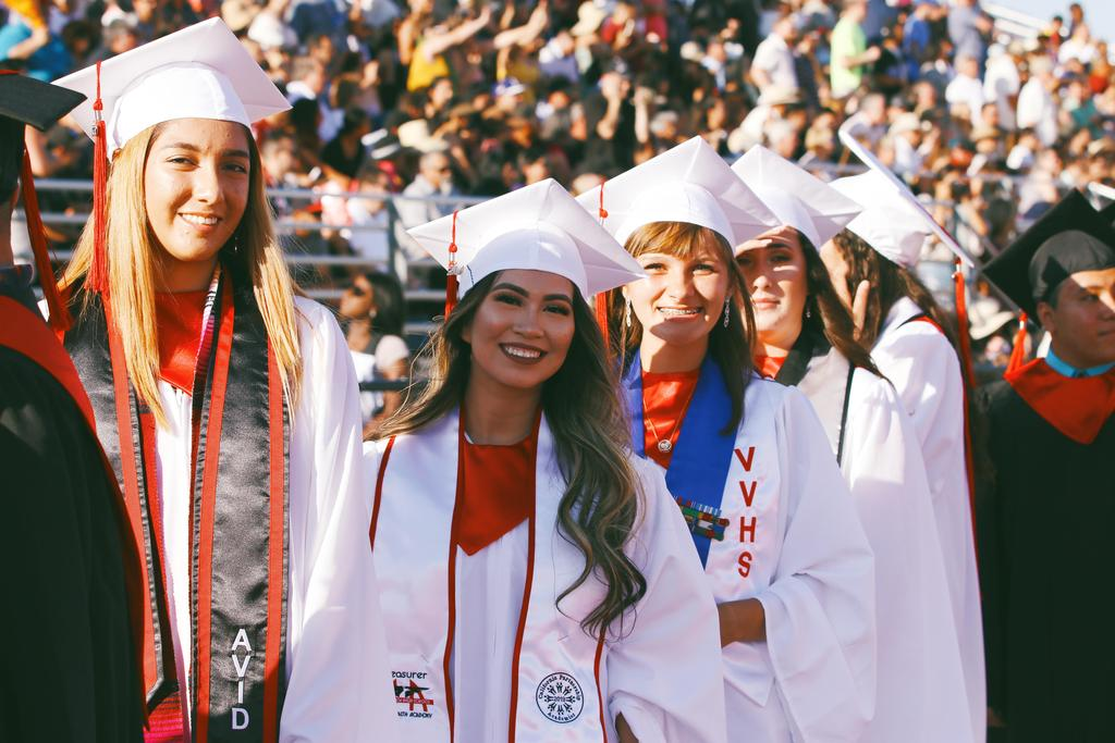 Class of 2019 graduates walk onto football field