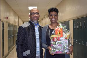 Superintendent Ellis gives Acts of Kindness Baskets to district employees.