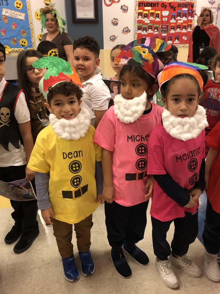 group of children dressed as colors of the rainbow
