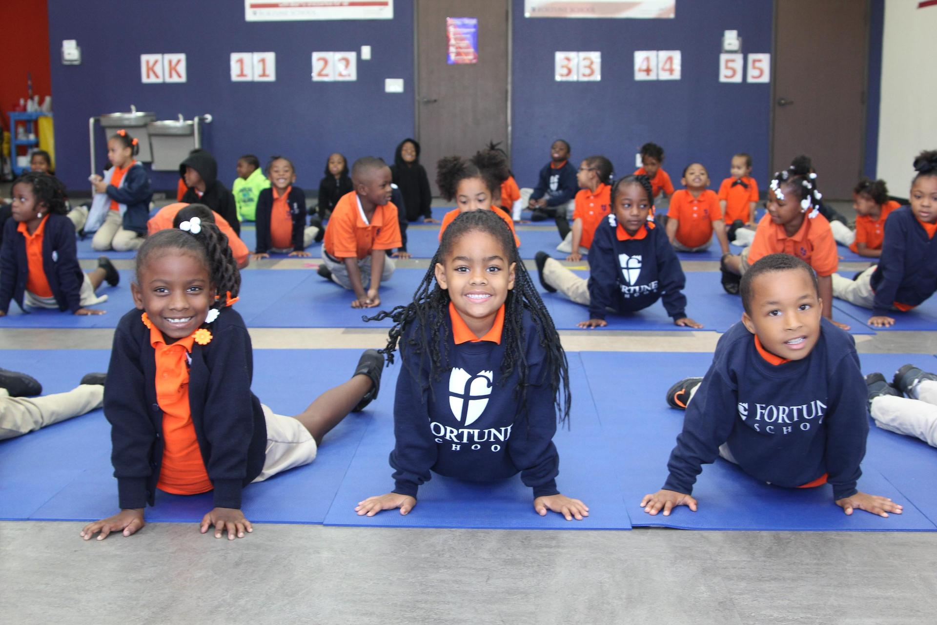 Kindergartners doing yoga