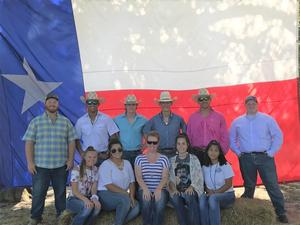 east ffa members standing in front of a texas flag