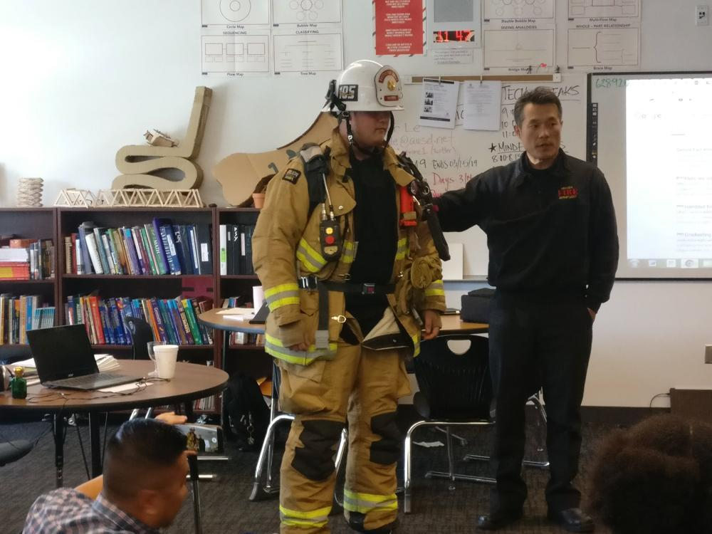 One of our Rancho students stands in full firefighter gear during one of our guest speaker sessions with a local fire crew