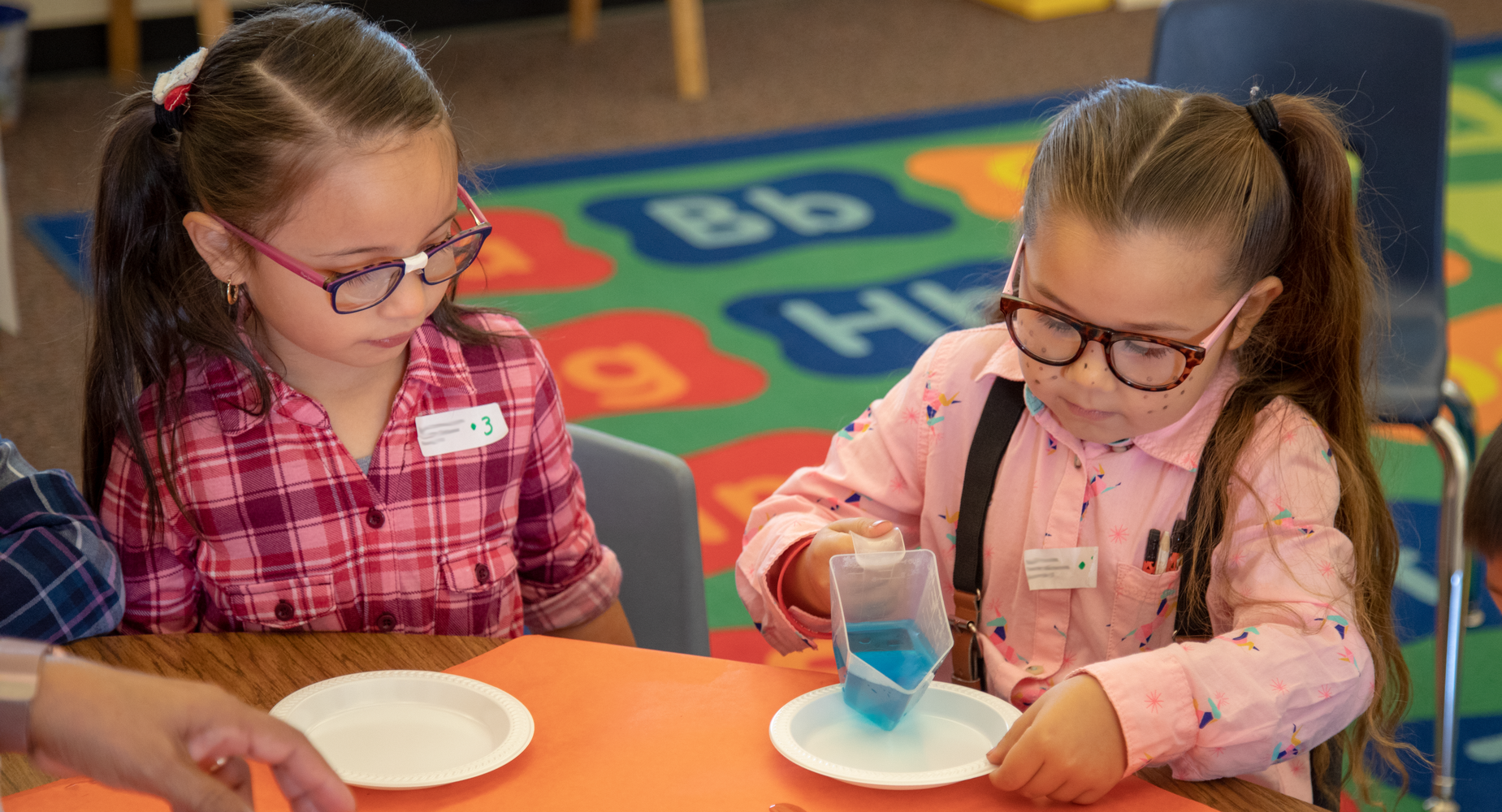 Two students conducting a science experiment