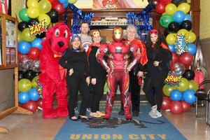 RWS Administration dressed as super hero's with Iron Man
